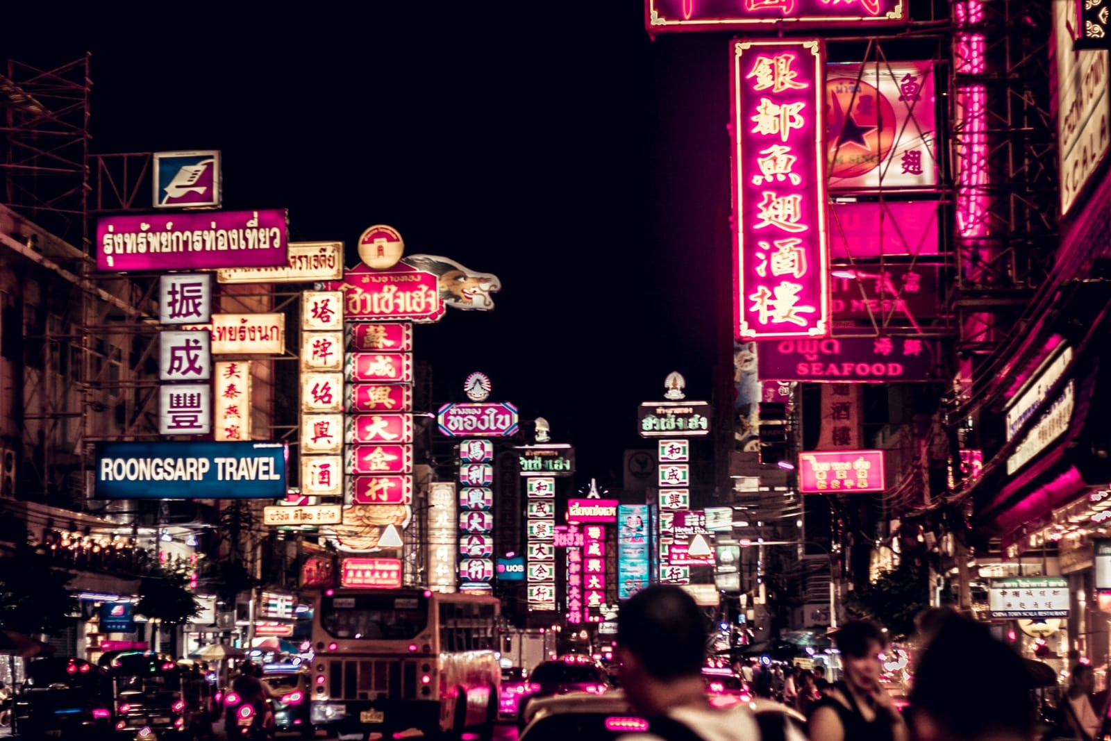 people walking along road filled with LED signages
